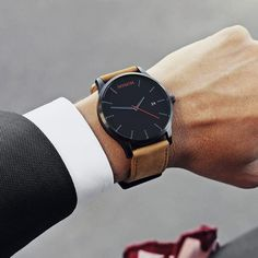 This black & tan leather watch from MVMT is as versatile as it is beautiful. Fitting in casual, formal, or professional settings, for under $100 this watch does it all.