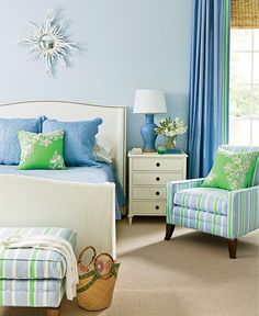 Plush, elegant furnishings decorated in blue, green, and white outfit this Florida home. Shop the look at Wayfair