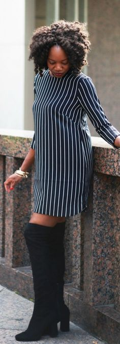 A short striped dress with a pair of black knee high boots for a transition look