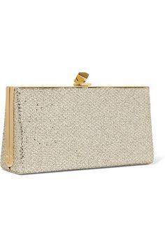 Silver and gold glittered canvas Clasp fastening at top Designer color: Champagne Comes with dust bag Made in Italy