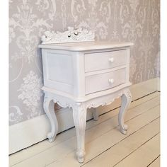A beautiful French-style bedside table in pure white