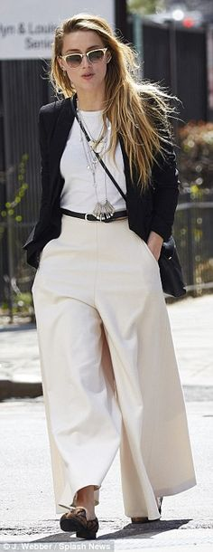 On a roll: Amber Heard was spotted out and about in NYC earlier on Wednesday wearing wide-...