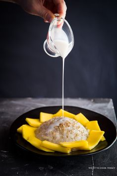 Coconut Sticky Rice with Mango (Khao Niao Mamuang) is popular gluten-free Thai dessert made of white sticky rice/sweet rice/glutinous rice cooked and then served with coconut milk, slices of mango, and sprinkle of sesame seeds
