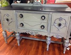 Check out this enchanting buffet by Rustic Roots! This stunner was restyled in Empire Gray Chalk Style Paint, Java Gel Stain, then accented with Argentine Pearl Effects! Learn creative techniques using General Finishes Pearl Effects at https://www.youtube.com/watch?v=qRyD4KtypkU.
