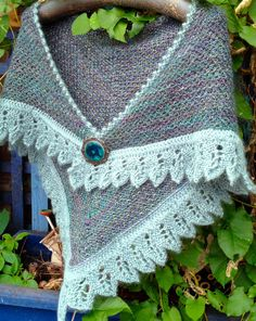 Free Knitting Pattern for Crow Waltz Shawl - Triangle shaped shawl knit with 2 colors woven slip stitch pattern and decorative lace edge. Designed by Juju Vail. Pictured project by PincusPanther, Sport weight yarn. A rectangular version is also available.