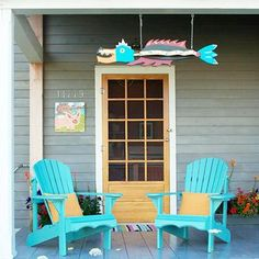 ❤ Go for color- Make even a small porch special by using colorful chairs and accessories. Here, two bright turquoise Adirondack chairs and whimsical folk art set the tone.