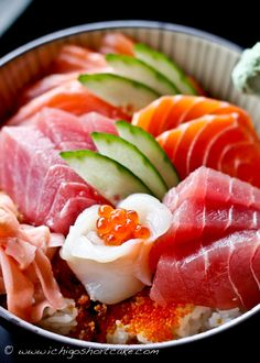 "Salmon & Tuna Chirashi - The word ""chirashi"" in Japanese means ""scattered,"" so this is basically a big bowl of rice mixed with fish, vegetables, and additional ingredients of your choice. It's a delicious one-bowl meal that is very filling and very versatile. There are almost no limits to what ingredients go in chirashi, and if you're a vegetarian, you could make a vegetable-only chirashi."