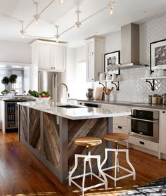 It's the little things that make a space unique. The zig zag pattern of the reclaimed wood island is the perfect echo of the herringbone backsplash.