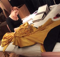 Intern Jessa Johnson notes the fiber content of the canary yellow Ungaro. Photograph by Museum staff. Conservation, Behind The Scenes, Fiber, Photograph, Take That, Museum, Notes, Content, Yellow