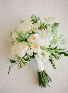 Hand Tied White & Green Wedding Bouquet Arranged With: White Peonies, White English Garden Roses, White Lisianthus, White Clematis, Other White Florals + Greenery & Foliage