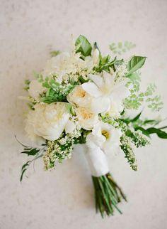 Hand Tied White & Green Wedding Bouquet Arranged With: White Peonies, White English Garden Roses, White Lisianthus, White Clematis, Other White Florals + Greenery & Foliage