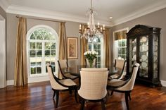 Love the round table, the upholstered chairs, and the hardwood floor color.
