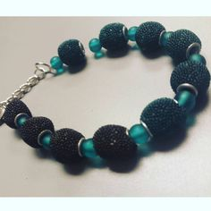 Check out this item in my Etsy shop https://www.etsy.com/listing/473170990/peacock-colored-bracelet-beaded-bracelet
