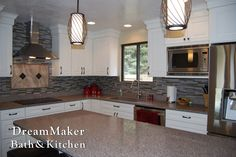 Check out the gray tile back splash with the white cabinets!