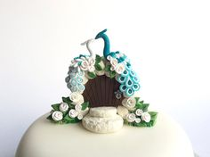 Teal and white peacock themed wedding cake topper by fizzyclaret