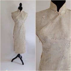 Vintage 60s cheongsam or Asian style dress Made of a beautiful white and silver brocade fabric Fully lined with white silk Side closure with