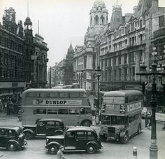 Tottenham Court Road/Oxford Street junction in the A great shot of this location when traffic was two-way. The Dominion Theatre, just seen on the extreme right. The Dominion Theatre was used for many years as a cinema. London Pictures, London Photos, Old Pictures, Old Photos, London History, British History, Vintage London, Old London, London Bus