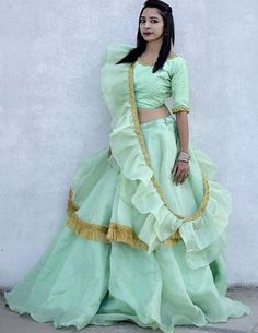 Beautiful organza Lehenga-Choli with modern silhouettes and superb embellishments. Paired with frill dupatta and implementation of golden Patti. Choli Designs, Lehenga Designs, Blouse Designs, Indian Lehenga, Lehenga Choli, Lehenga Blouse, Indian Designer Outfits, Indian Outfits, Lehnga Dress