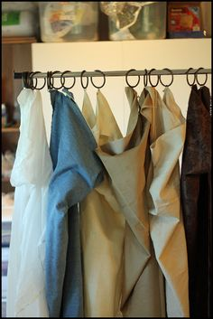 If you take photos at home make your own photography backdrop using a cheap garment rack and hang drapes or fabric of your choice from it. Clever idea!