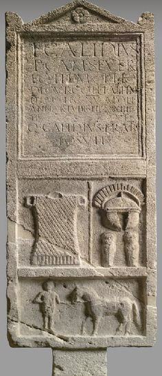 Tombstone of Titus Calidius Severus 0-100 A.D. Tombstone of T. Calidius Severus with his armour, helmet, and greaves. He died at the age of 58, after 34 years of service. He was centurion of the XVth legion stationed in Carnuntum, Austria. At the bottom his stable boy. Limestone, H:205 cm Inv. III 365   Kunsthistorisches Museum, Antikensammlung, Vienna, Austria