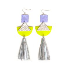 These gorgeous geometric hand cut leather earrings were made with a focus on form and minimal color. I hand cut a neon yellow leather half circle with white leather triangles which hang below a lavender light purple leather square. Below the geometric cut out are holographic silver hand cut leather tassels. Very futuristic and chic! - The back of the earrings are white and purple suede. Neon is only on the front side. - Earring hooks are silver plated bronze. - Hardware is nickel and l...