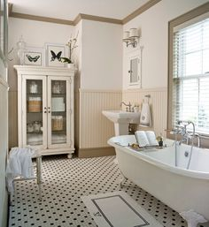 Country style bathroom with claw foot tub.