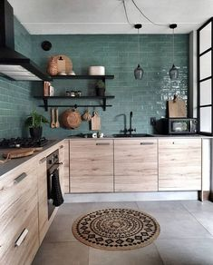 The texture of the wood cabinets against the lines of the green tile backsplash. This kitchen does balance right! ( The texture of the wood cabinets against the lines of the green tile backsplash. This kitchen does balance right! Home Decor Kitchen, Kitchen Interior, New Kitchen, Home Kitchens, Bohemian Kitchen Decor, Bohemian Interior, Dark Green Kitchen, Kitchen Modern, Wooden Kitchen