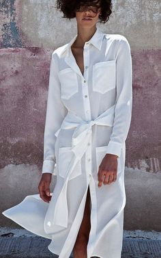 This **Christina Economou** Rani White Long Wrap Shirt Dress features front patch pockets, relaxed silhouette, and self tie at waist. Virtual Fashion, Fashion 2017, Fashion Dresses, Womens Fashion, Luxury Fashion, Outfit Vestidos, Minimal Dress, White Outfits, Mode Outfits
