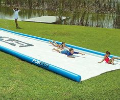 Become the most popular kid on the block by sprawling this giant 50 foot slip and slide in your backyard. It's made using an extremely durable material and features a super slick surface that won't require a lubricant to send you barreling down it. Giant Slip And Slide, Slip N Slide, Homemade Slip And Slide, Giant Water Slide, Water Toys, Water Play, Outdoor Games, Outdoor Play, Outdoor Activities