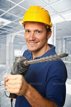 Buy worker with electric drill by copperpipe on PhotoDune. handyman holding electric drill and construction site background Hard Hats, Hammer Drill, Tool Belt, Electric, Woodworking, Stock Photos, Author, Construction, Search