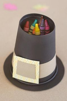 Pilgrim hat coloring bin and more Thanksgiving place settings kids can make