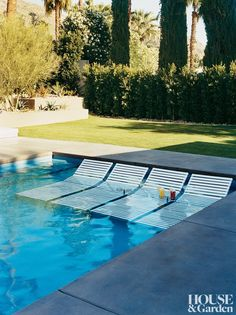 For the shallow end of the pool on a Palm Springs, California, property, landscape architect Steve Martino designed stainless-steel cup holders that sit an inch and a half above the water and accompanying stainless-steel and vinyl-strapped chaises.