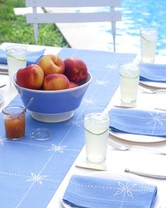 Create the look of batik with a bleach pen on a blue runner and napkins for a coordinated table setting.