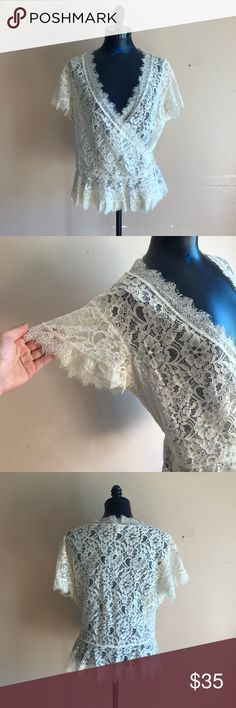 Joie Lace Wrap Top Stunning Joie Lace Wrap Top. This is super pretty and in almost new condition. Cream color. There are endless outfit possibilities with this piece! Joie Tops Blouses