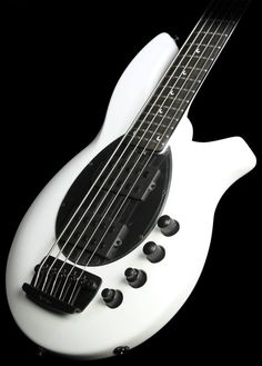 Check this gorgeous Ernie Ball Music Man Bongo 5 HH Five String Electric Bass in Stealth White with black pickguard! The Maple neck is secured with a 5-bolt joint and Custom lightweight tuners provide easy, precise tuning. Dual humbucking pickups with Neodymium magnets provide a fat, punchy sound, while an active 4-band preamp offers all the tone sculpting you could need, plus a pickup balance for the ultimate control. WOW!