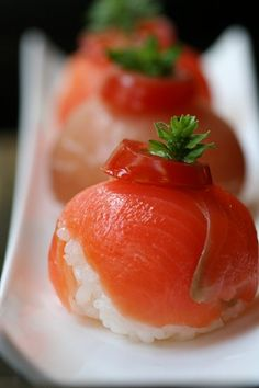 Sushi:  Salmon Temari-zushi topped with Tomato and Basil, Prosciutto in the background