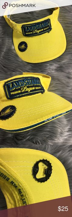 Landshark Lager Margaritaville Embroidered Visor Landshark Lager Margaritaville Embroidered Yellow Visor Built In Bottle Opener There is a small area of damaged fabric under the bottle opener; does not affect wear/use No other flaws Patch has a distressed raw edge look Sold as pictured Landshark Accessories Hats