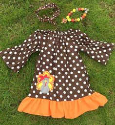 Super adorable Fall Turkey Dress! This can be worn as a dress or paired with leggings. 3 piece set includes a matching necklace and headband Available in sizes 4T, 5, 6 ,7