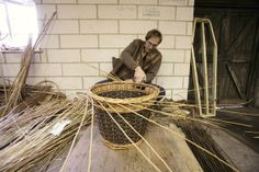 Credit: Sam Frost Coate finishing off a willow basket; the final weave, around the top, is known as the border