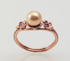 Pink Pearl Ring in 14K rose gold by FernandoJewelry on Etsy, $725.00 ughhhhh rose gold is my favorite why is this so stupid expensive grrrrr