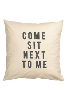 JAMES & LUCY SITTING ROOM / DESIGN ESSENTIALS  Text print cushion cover: Cushion cover in a cotton weave with a text print on the front, solid colour back and concealed zip.