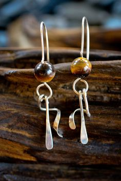 Spiral Dangle Earrings in Sterling Silver and Tiger's Eye - these look like people sitting - or maybe it's just me ;)