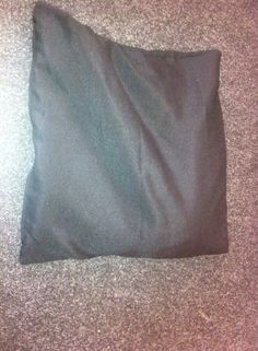 This is our handmade weighted cushion. These can be made really cheaply with rice and a couple of cushion covers - no sewing necessary.  http://www.sensoryspacebristol.com/?p=400