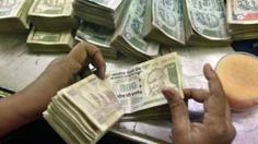 "Image copyright                  Reuters                  Image caption                                      Undeclared income or ""black money"" is a huge issue in India                                A tax evasion amnesty in India has prompted tens of thousands of people to declare more than $9.5bn (£7.3bn) in undeclared income and assets. Finance min"