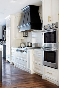 Interior Design Ideas (love the gold knobs on cabinets, stove & oven and the black range hood)