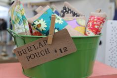 Craft fair. Bright display bucket mirrors bright, fun patterns on items.