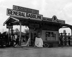 Richfield Gasoline, Gilmore Gasoline, and other signs adorn a service station at Long Beach Boulevard in South Gate, California. It was owned and operated by Louie Meyers and his wife, June (June Via the Herald-Examiner collection Old Gas Pumps, Vintage Gas Pumps, Pictures Of Gases, Pompe A Essence, Gas Service, Automobile, Old Gas Stations, Old Country Stores, Photography