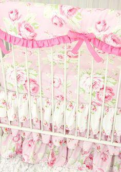 close up view of pink vintage floral crib bedding set