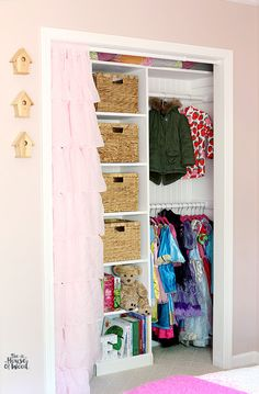 IHeart Organizing | Tips for DIYing a custom closet... copy cat the way she installed the poles and maybe tie in to an IKEA Kallax shelf.