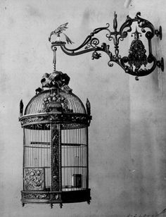 The blog does not have a description. I don't know if the person made it, knows someone who made it, maybe they photographed it for someone, I just don't know. It's beautiful however it came to be. Scrollwork hook and an intricate yet simple birdcage and the two look amazing together. Were they made by one person or strangers? (I have not searched google yet) -Em